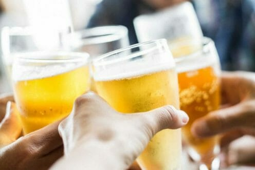 hands holding glasses of beer