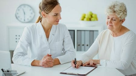 A woman consulting with a medical professional